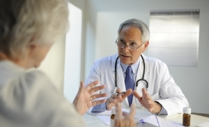 Doctor conversing with patient